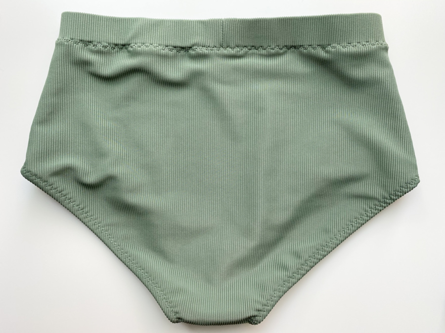 Vernazza swim suit bottoms in ribbed tricot, back view, flat lay