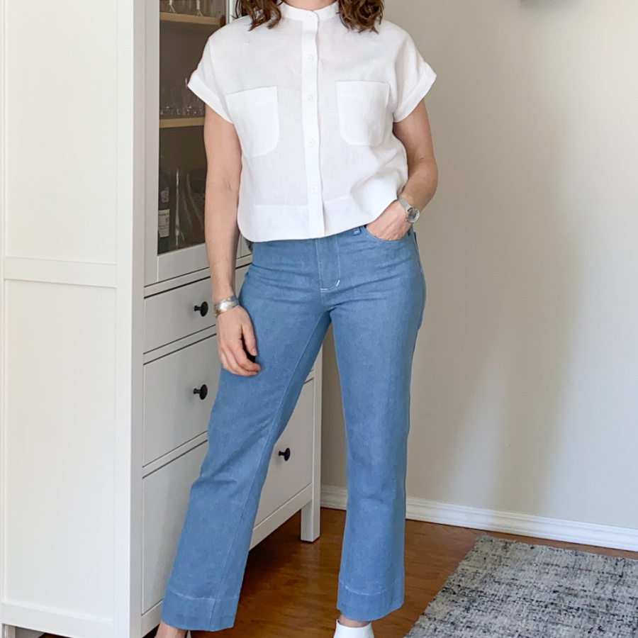 White linen Kalle Shirt worn with light blue Ginger jeans, front view.