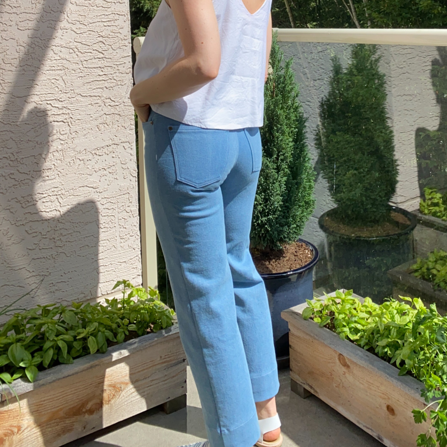 white modified Ogden cami and wide leg, light wash ginger jeans, left side view