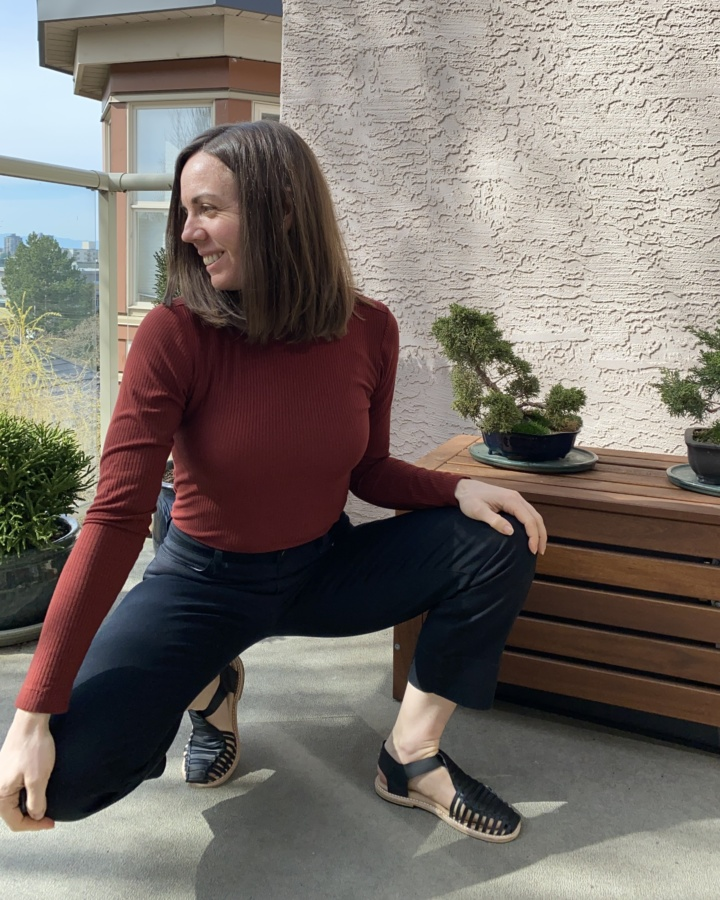 Me, crouching, wearing Astrid sandals, black jeans and rust coloured turtleneck